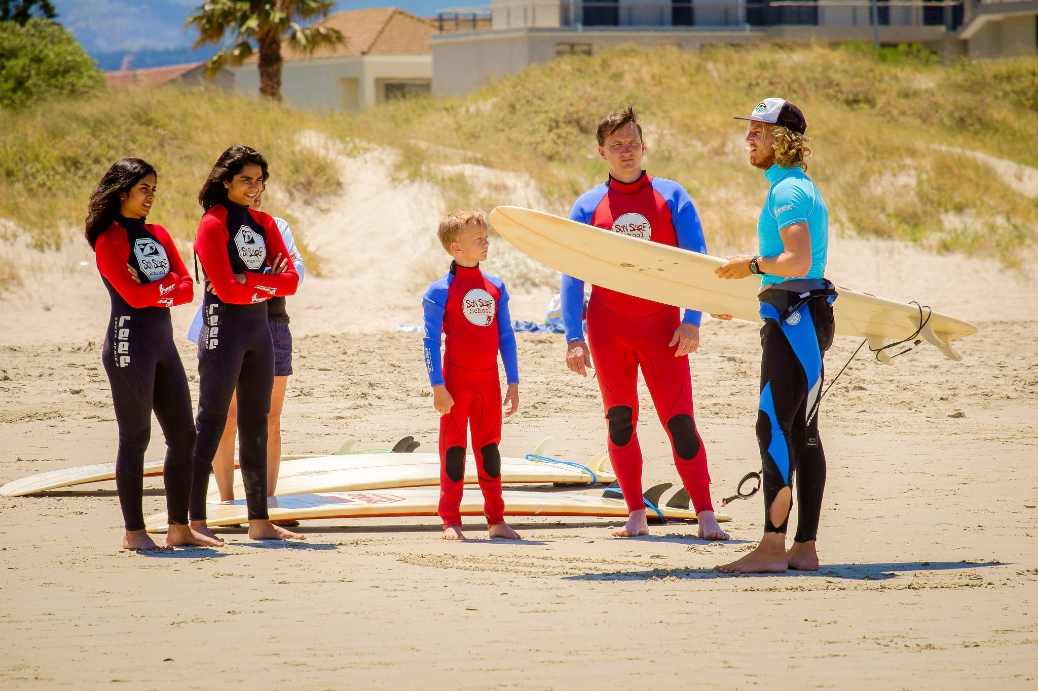 Surf school instructor with clients